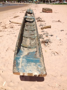 Handmade dug out canoe used for hauling.